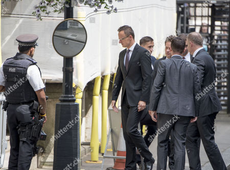 Jul 6 2017 - London United Kingdom - Hungarian Foreign Minister Péter Szijjártó Centre Arrives at 9 Downing Street For Brexit Talks with David Davies 6th July 2017 Â