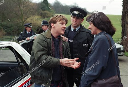 Nick is in a terrible state after shooting one of the poachers, fearing he that they might harm Alice. He gives himself up and is arrested and cautioned for the murder of Jed. He screams to see Alice as he is taken away - With Nick Bates, as played by Cy Chadwick. (Ep 2072 - 16th April 1996).