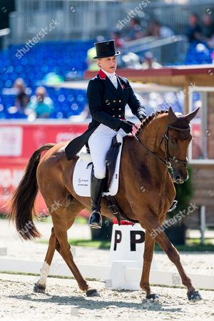 Kristina Cook of Great Britain on Billy the Red competes in the dressage competition at the FEI European Championships Eventing in Strzegom, Poland, 18 August 2017.