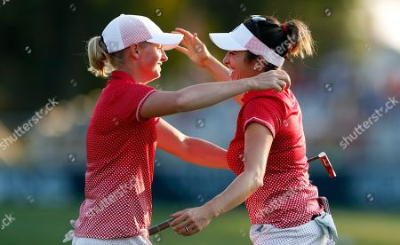 Stacy Lewis, Gerina Piller United States' Stacy Lewis, left, celebrates with playing partner Gerina Piller after their four-ball match win over Europe's Charley Hull and Georgia Hall in the Solheim Cup golf tournament, in West Des Moines, Iowa