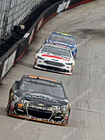Dale Earnhardt Jr., Matt DeBenedetto, Jimmie Johnson Driver Dale Earnhardt Jr. (88) leads Matt DeBenedetto (32) and Jimmie Johnson during practice for the NASCAR Monster Energy Cup auto race, in Bristol, Tenn