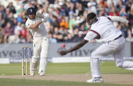 England player Jonathan Bairstow (Yorkshire) drives back past bowler ,West Indies player Jason Holder during the 1st Test Match, Day 2, between England and West Indies at Edgbaston, Birmingham on August 18