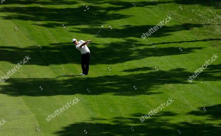 Hunter Mahan hits a shot from the 18th fairway during the second round of the Wyndham Championship golf tournament in Greensboro, N.C