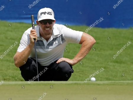 Hunter Mahan lines up a putt on the 18th hole during the second round of the Wyndham Championship golf tournament in Greensboro, N.C