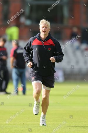 Lancs coach Glen Chapple warms up during the Natwest T20 Blast North Group match between Lancashire Lightning and Birmingham Bears at the Emirates, Old Trafford, Manchester