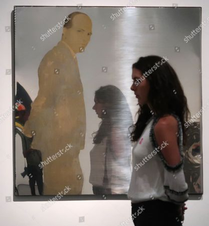 A museum goer is reflected in the work of art 'Persona Che Guarde' (1963) by Italian artist Michelangelo Pistoletto at the Los Angeles County Museum of Art (LACMA) in Los Angeles, California, USA, 18 August 2017.