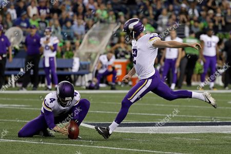 Minnesota Vikings kicker Kai Forbath, right, kicks a field goal as punter Ryan Quigley (4) holds, during the first half of an NFL football preseason game against the Seattle Seahawks, in Seattle