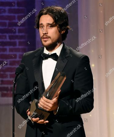 """Stock Photo of Peter Gadiot accepts award for best supporting actor - television for """"Queen of the South"""" at the 32nd annual Imagen Awards at the Beverly Wilshire Hotel, in Beverly Hills, Calif"""