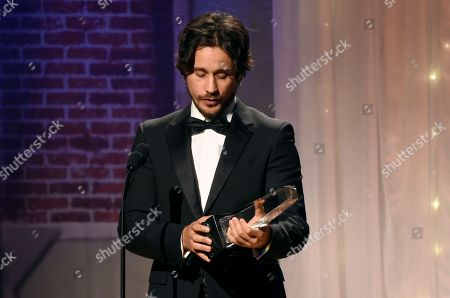 """Peter Gadiot accepts award for best supporting actor - television for """"Queen of the South"""" at the 32nd annual Imagen Awards at the Beverly Wilshire Hotel, in Beverly Hills, Calif"""