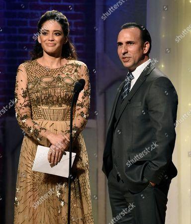 Edurne Ganem, Oscar Torre Edurne Ganem, left, and Oscar Torre speak at the 32nd annual Imagen Awards at the Beverly Wilshire Hotel, in Beverly Hills, Calif