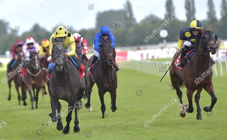 (L) Defoe (Andrea Atzeni) wins The Betfred Geoffrey Freer Stakes from (R) Wall Of Fire (Josephine Gordon) at Newbury Racecourse on Saturday 19th August 2017.