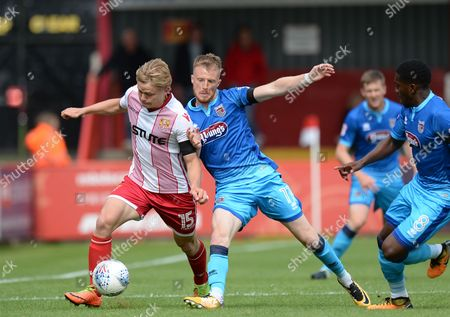 Sam Kelly of Grimsby Town challenges Alex Samuel of Stevenage (left) for the ball