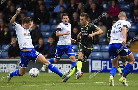 Tom Nichols of Bristol Rovers takes on Alex Bruce of Bury
