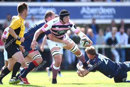 Seb Davies of Cardiff Blues is tackled by Jonathan Mills and Chris Walker of London Scottish.