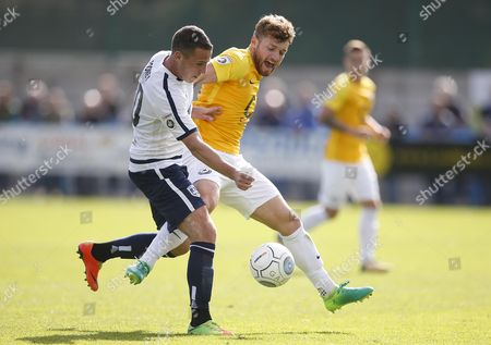 Torquay United player Ryan Higgins and Guiseley player John Rooney compete during the English National League game between Guiseley and Torquay United at Nethermoor Park on Aug 19