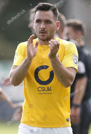 Torquay United player Jake Gosling applauds the travelling fans during the English National League game between Guiseley and Torquay United at Nethermoor Park on Aug 19