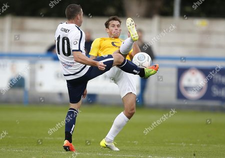 Torquay United player Damon Lathrope toe to toe with Guiseley player John Rooney during the English National League game between Guiseley and Torquay United at Nethermoor Park on Aug 19