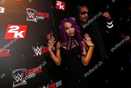Sasha Banks, Snoop Dogg WWE Superstar Sasha Banks and DJ Snoopadelic A.K.A Snoop Dogg are seen at the WWE 2K18 SummerSlam Kickoff Event, in New York