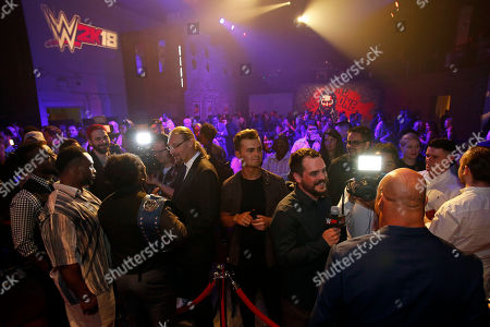 Kurt Angle, The New Day WWE Superstars The New Day and WWE Hall of Famer Kurt Angle are seen at the WWE 2K18 SummerSlam Kickoff Event, in New York
