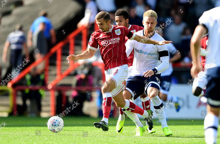 Gary O'Neil of Bristol City challenges for the ball with Byron Webster of Millwall