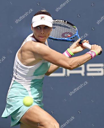 Vera Zvonareva (RUS) prepares to hit a backhand during her first round, qualifying match vs. Anastasia Rodionova at the WTA Connecticut Open. Zvonareva won the match 2-6, 6-3, 6-1