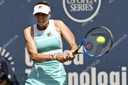 Vera Zvonareva (RUS) hits a backhand during her first round, qualifying match vs. Anastasia Rodionova at the WTA Connecticut Open. Zvonareva won the match 2-6, 6-3, 6-1