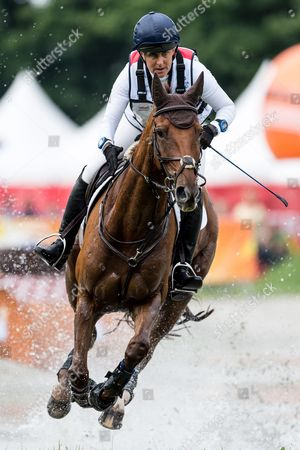 Kristina Cook of Britain on horse Billy the Red competes in the Cross Country test competition during the FEI European Championships Eventing in Strzegom, Poland, 19 August 2017.