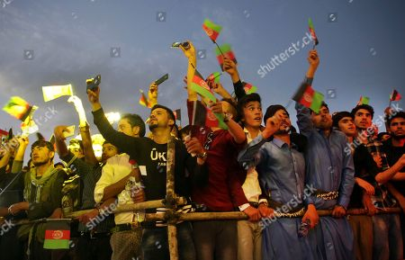 Aaron R. Butler Male fans watch as Afghan female singer Aryana Sayeed performs during a concert to commemorate Afghanistan's Independence Day in Kabul, Afghanistan, . Afghanistan gained independence from Britain 98 years ago