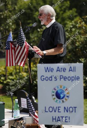 Stock Picture of The Reverend Ken Campbell, convener of the Nauset Interfaith Association, speaks during a rally organized by the Martin Luther King Action Team of the Nauset Interfaith Association for 'Unity in Diversity,' standing against the bigotry and violence witnessed a week ago in Charlottesville in Orleans, Massachusetts, USA, 19 August 2017. Approximately 170 people gathered on the Orleans Town Green for speeches, songs and a rally for support along Main St. and Route 28.