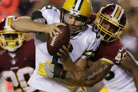 Joe Callahan, Pete Robertson Green Bay Packers quarterback Joe Callahan (6) is sacked by Washington Redskins linebacker Pete Robertson (45) during the second half of an NFL preseason football game in Landover, Md