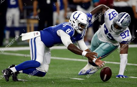 DJ Taco Charlton, Phillip Walker Indianapolis Colts quarterback Phillip Walker (8) reaches down to recover a bobbled snap under pressure from Dallas Cowboys defensive end DJ Taco Charlton (97) in the second half of a preseason NFL football game, in Arlington, Texas