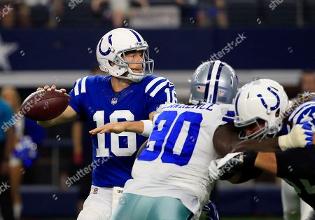 Stock Picture of DeMarcus Lawrence, Scott Tolzien Indianapolis Colts quarterback Scott Tolzien (16) prepares to throw a pass under pressure from Dallas Cowboys defensive end DeMarcus Lawrence (90) in the first half of a preseason NFL football game, in Arlington, Texas