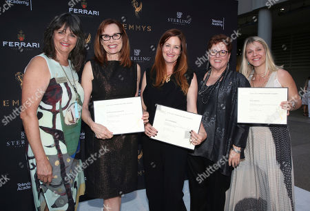 """Stock Image of Terry Ann Gordon, Sue Bub, Patricia McLaughlin, Alix Friedberg, Risa Garcia Television Academy's Terry Ann Gordon, from left, costume designers Patricia McLaughlin, Alix Friedberg, Risa Garcia, and Television Academy's Sue Bub pose with a plaque for their Emmy nomination for """"Big Little Lies"""" at the 11th annual """"Art of Television Costume Design"""" opening at the FIDM Museum & Galleries on the Park on in Los Angeles"""