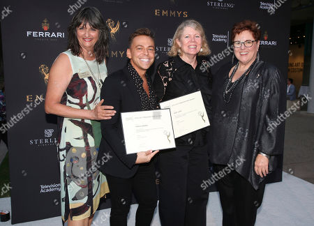 """Stock Image of Terry Ann Gordon, Sue Bub, Paolo Nieddu, Mary Lane Television Academy's Terry Ann Gordon, from left, costume designers Paolo Nieddu, Mary Lane, and Television Academy's Sue Bub pose with a plaque for their Emmy nomination for """"Empire"""" at the 11th annual """"Art of Television Costume Design"""" opening at the FIDM Museum & Galleries on the Park on in Los Angeles"""