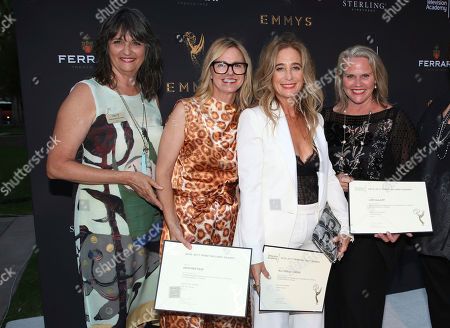 """Paolo Nieddu, Mary Lane, Heather Pain, Allyson B. Fanger, Lori DeLapp Television Academy's Terry Ann Gordon, from left, costume designers Heather Pain, Allyson B. Fanger, Lori DeLapp, and Television Academy's Sue Bub pose with a plaque for their Emmy nomination for """"Grace and Frankie"""" at the 11th annual """"Art of Television Costume Design"""" opening at the FIDM Museum & Galleries on the Park on in Los Angeles"""