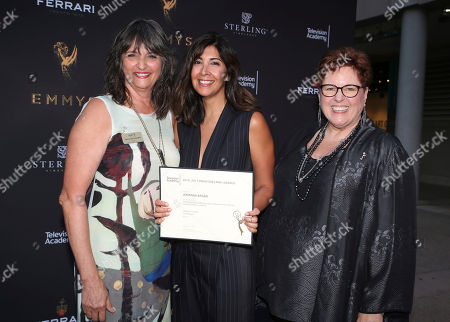 """Terry Ann Gordon, Sue Bub, Johanna Argan Television Academy's Terry Ann Gordon, from left, costume designer Johanna Argan, and Television Academy's Sue Bub pose with a plaque for their Emmy nomination for """"House of Cards"""" at the 11th annual """"Art of Television Costume Design"""" opening at the FIDM Museum & Galleries on the Park on in Los Angeles"""