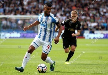Huddersfield Town's Elias Kachunga and Newcastle United's Matt Ritchie