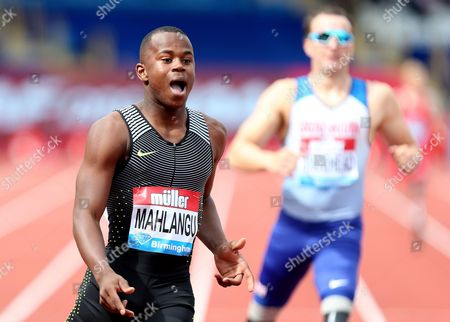 Ntando Mahkangu of South Africa crosses the line after winning the Mens 200m T42 against Richard Whitehead of Great Britain.