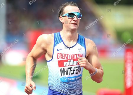Richard Whitehead of Great Britain crosses the line after the Mens 200m T42.