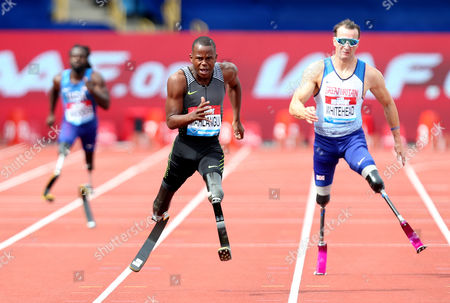 Ntando Mahkangu of South Africa on his way to winning the Mens 200m T42 against Richard Whitehead of Great Britain.