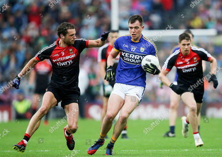 Kerry vs Mayo. Mayo's Tom Parsons with Jack Barry of Kerry