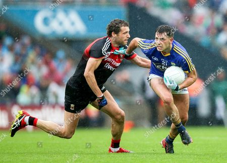 Kerry vs Mayo. Mayo's Tom Parsons with Jack Savage of Kerry