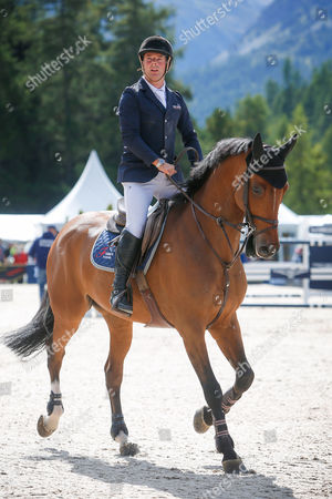 """Robert Whitaker of Britain on """"Catwalk IV"""" second place, in action during the Grand Prix, at the Longines CSI St. Moritz horse jumping competition, in St. Moritz, Switzerland, 20 August 2017."""