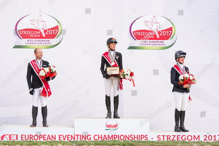 Ingrid Klimke (C) of Germany celebrates on the podium after winning the gold medal of the FEI European Championships Eventing in Strzegom, Poland, 20 August 2017. Michael Jung of Germany (L) won silver and Nicola Wilson of Britain won bronze.
