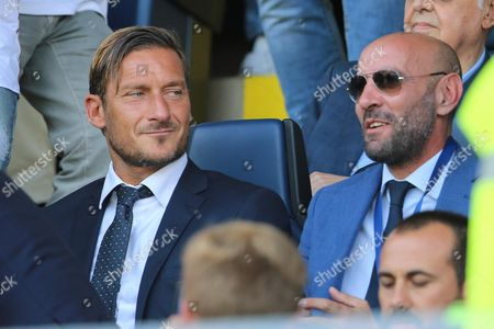 AS Roma's Sport Director, Ramon Rodriguez Verdejo 'Monchi' (R) reacts next to Italian AS Roma's former soccer player Francesco Totti during the Italian Serie A soccer match between Atalanta and AS Roma at the Atleti Azzurri d'Italia stadium in Bergamo, Italy, 20 August 2017.