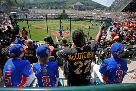 Anderew McCutchen, Matthey Greene, Tommy Harris, Branden Campbell Grosse Pointe, Mich.'s players Matthew Greene (5), Tommy Harris (2), and Branden Campbell (3) sit with Pittsburgh Pirates' Andrew McCutchen (22) in the stands at Lamade Field during a baseball game between Fairfield, Conn., and Lufkin, Texas in United States pool play at the Little League World Series tournament in South Williamsport, Pa., . The Pirates will be playing the St. Louis Cardinals in Bowman Stadium in Williamsport, Pa., on Sunday Night Baseball