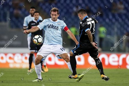 Lazio's Senad Lulic (L) and Spal's Federico Viviani (R) in action during the Italian Serie A soccer match between SS Lazio and Spal Ferrara at the Olimpico Stadium in Rome, Italy, 20 August 2017.