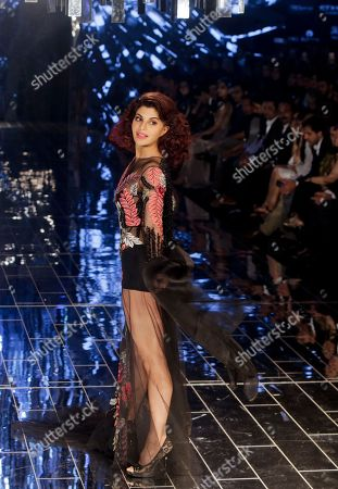 Bollywood actress Jacqueline Fernandez displays a creation by Manish Malhotra during the grand finale of Lakme Fashion Week 2017 in Mumbai, India