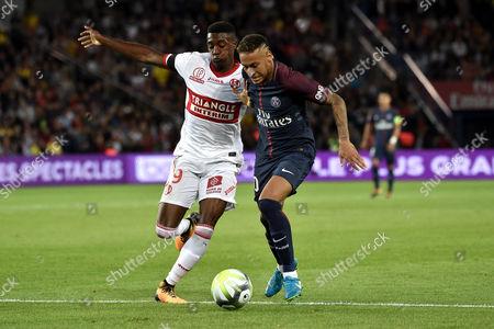 Stock Photo of Paris Saint Germain's Neymar Jr (R) in action against Toulouse's Yaya Sanogo (L) during  the French Ligue 1 soccer match between Paris Saint Germain (PSG) and Toulouse FC (TFC) at the Parc des Princes stadium in Paris, France, 20 August 2017.