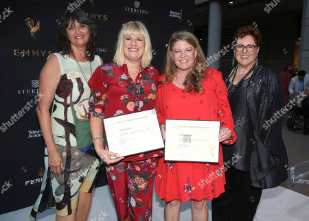 """Terry Ann Gordon, Sue Bub, Marie Schley, Leslie Herman Television Academy's Terry Ann Gordon, from left, costume designers Marie Schley, Leslie Herman, and Television Academy's Sue Bub pose with a plaque for their Emmy nomination for """"Transparent"""" at the 11th annual """"Art of Television Costume Design"""" opening at the FIDM Museum & Galleries on the Park on in Los Angeles"""
